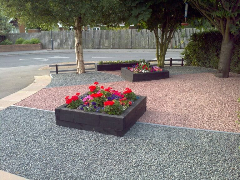 New softwood sleeper raised beds stained black on Scottish red granite and black basalt (dry)