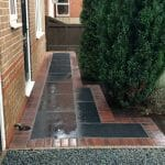 Stones4Homes 20mm Black Basalt (wet) with Kota Black Paving - Photo courtesy of DG Landscapes and Paving
